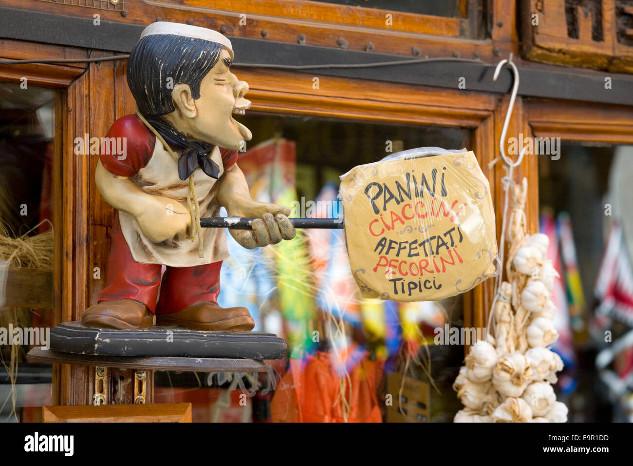 Siena, Tuscany, Italy. Amusing sign outside corner shop in Via Tito Sarrocchi selling traditional food products. Stock Photo