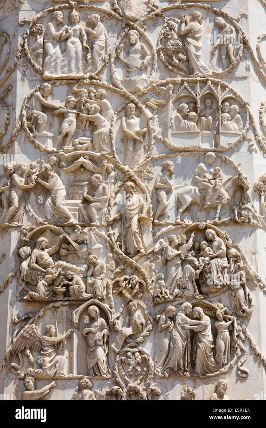 Orvieto, Umbria, Italy. Intricately carved bas-relief depicting scenes from the New Testament on façade of the cathedral. Stock Photo