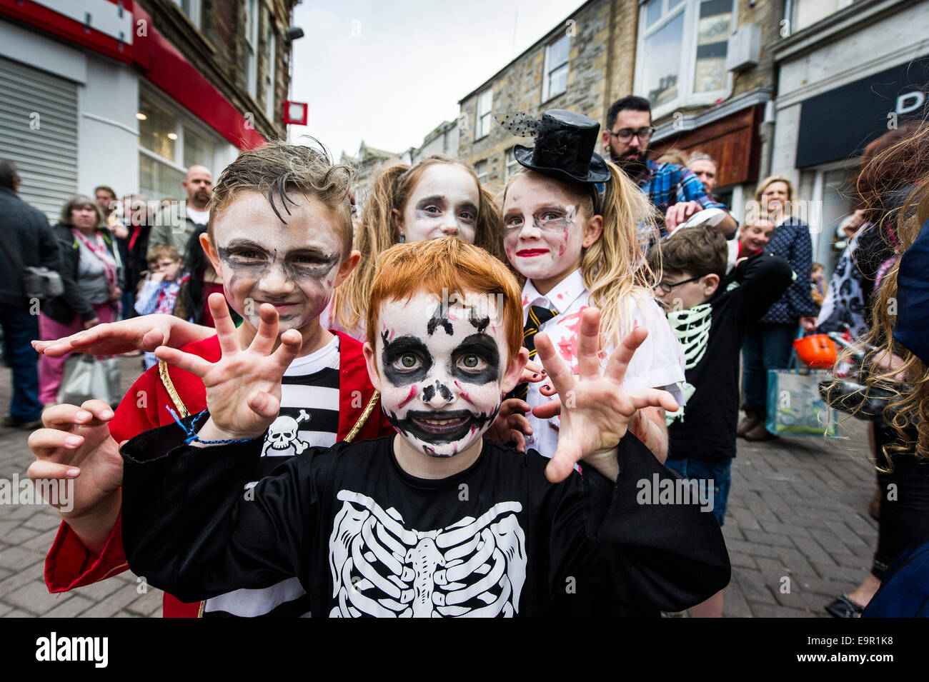 Newquay, Cornwall. 31st October 204.  Zombie Cornish children run wild along Newquay High Street. Credit:  Gordon - Stock Image
