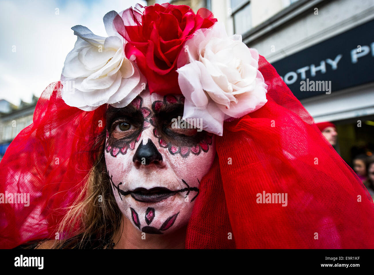 Newquay, Cornwall. 31st October 204.  A Cornish zombie bride walks to her wedding along Newquay High Street. Credit: - Stock Image