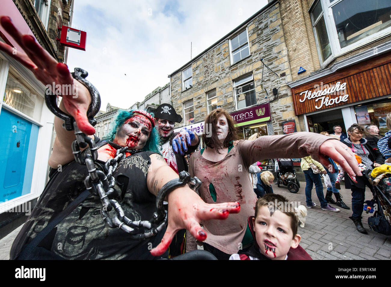 Newquay, Cornwall. 31st October 204.  Blood spattered Cornish zombies parade along Newquay High Street. Credit: - Stock Image