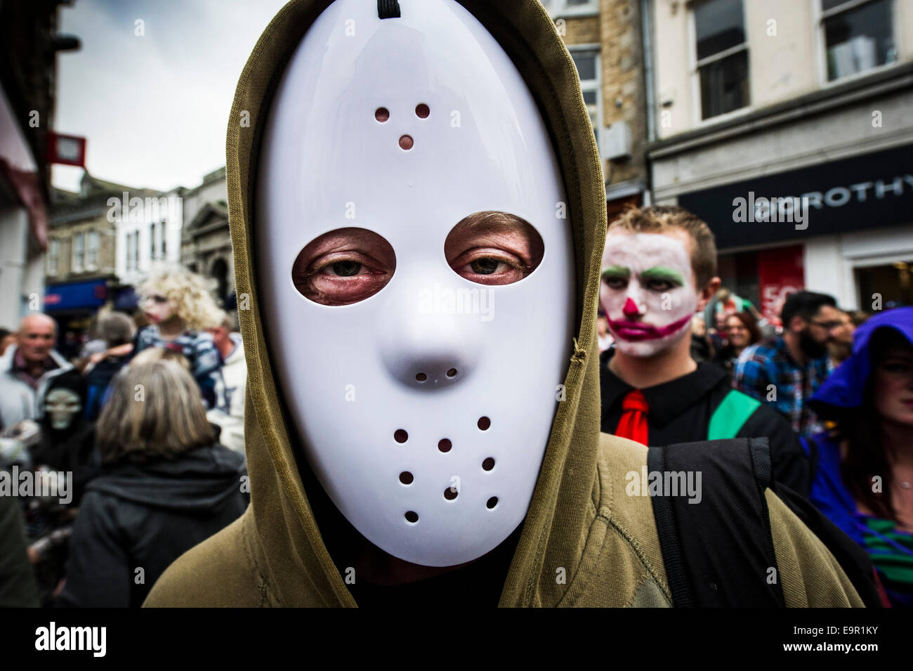 Newquay, Cornwall. 31st October 204.  A masked zombie stands in Newquay High Street. Credit:  Gordon Scammell/Alamy - Stock Image