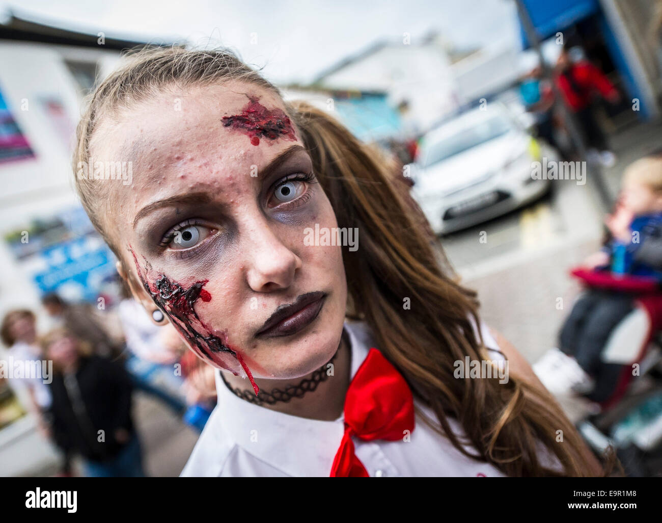 Newquay, Cornwall. 31st October 204.  Cornish zombies parade along Newquay High Street. Credit:  Gordon Scammell/Alamy - Stock Image