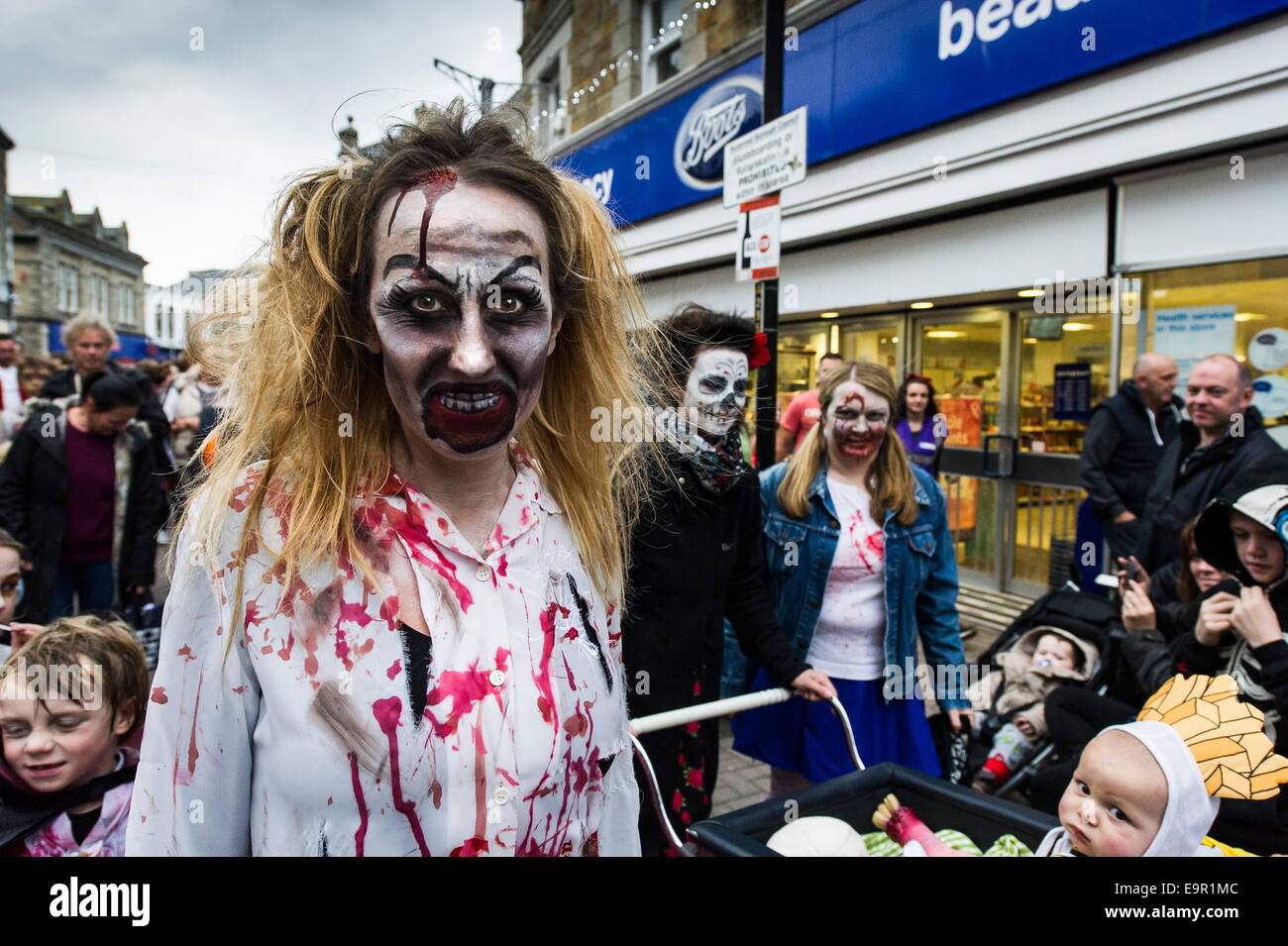 Newquay, Cornwall. 31st October 204.  Zombies parade along Newquay High Street. Credit:  Gordon Scammell/Alamy Live - Stock Image