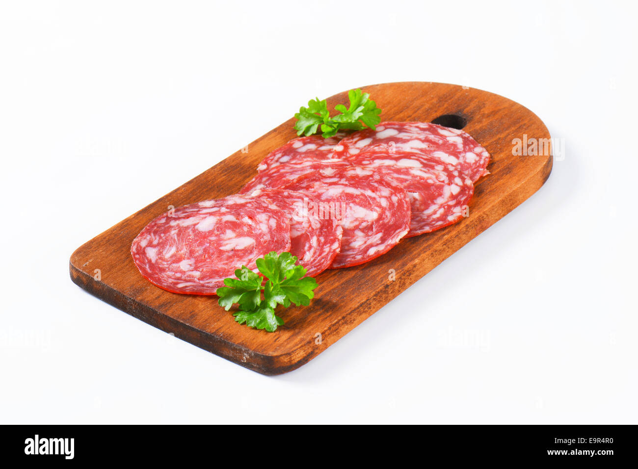 Spanish summer sausage made with Iberico pork - thinly sliced - Stock Image
