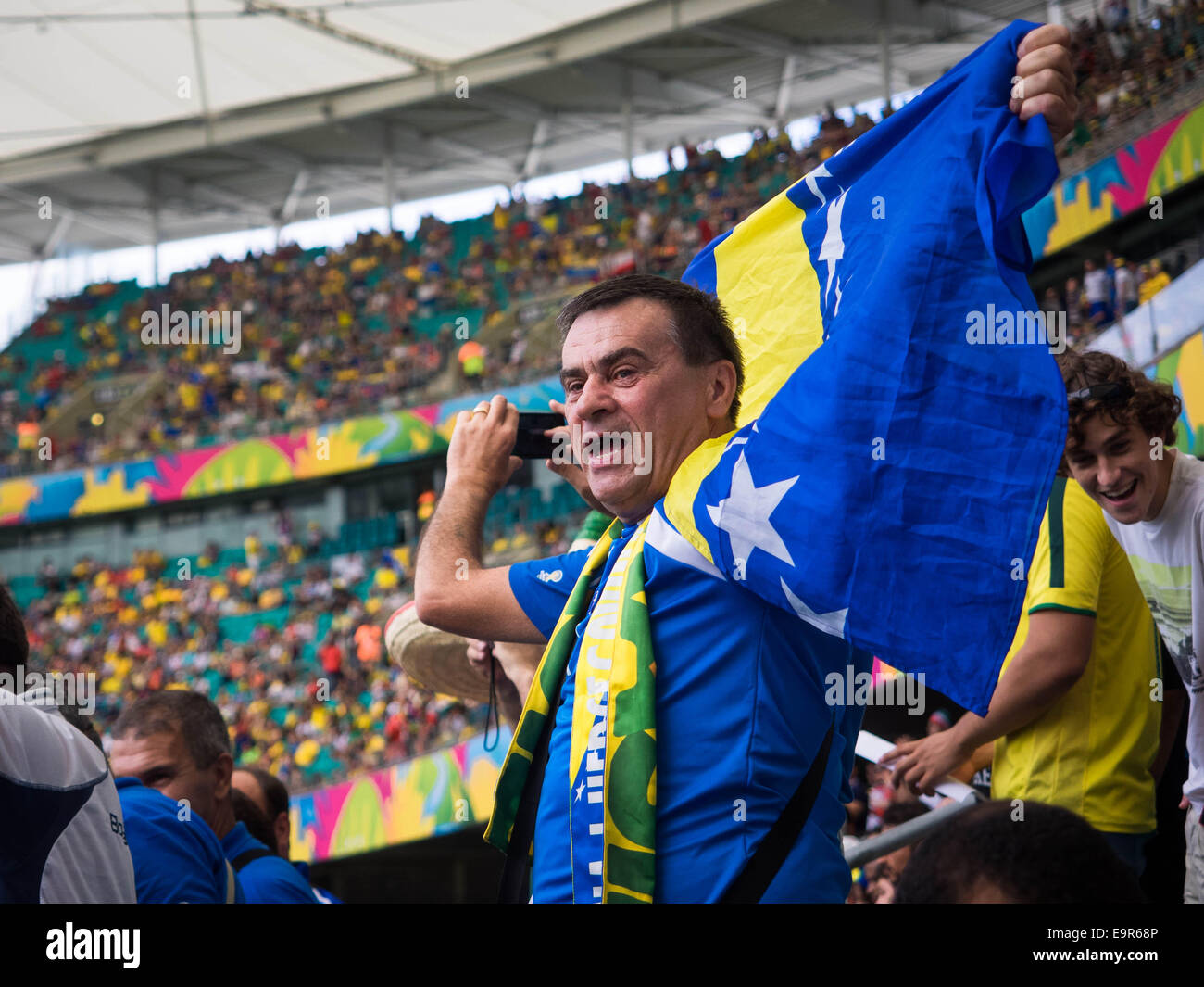 Bosnia and Herzegovina fan celebrating victory against Iran at World Cup match at Fonte Nova stadium in Salvador, - Stock Image