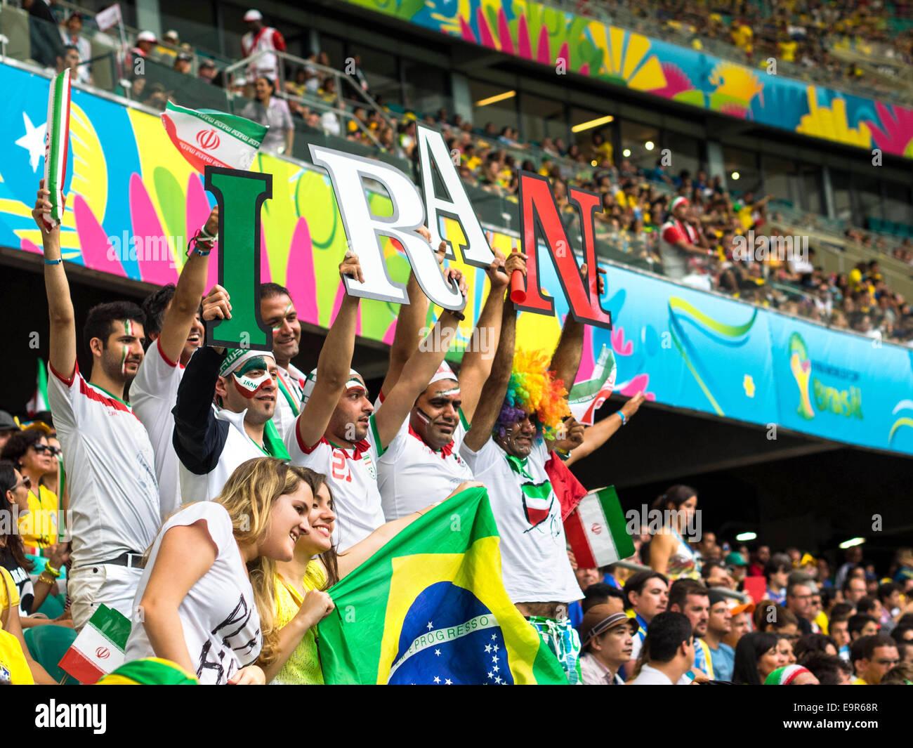 Iran football fans watching FIFA World Cup match against Bosnia and Herzegovina at Fonte Nova stadium, Salvador, - Stock Image