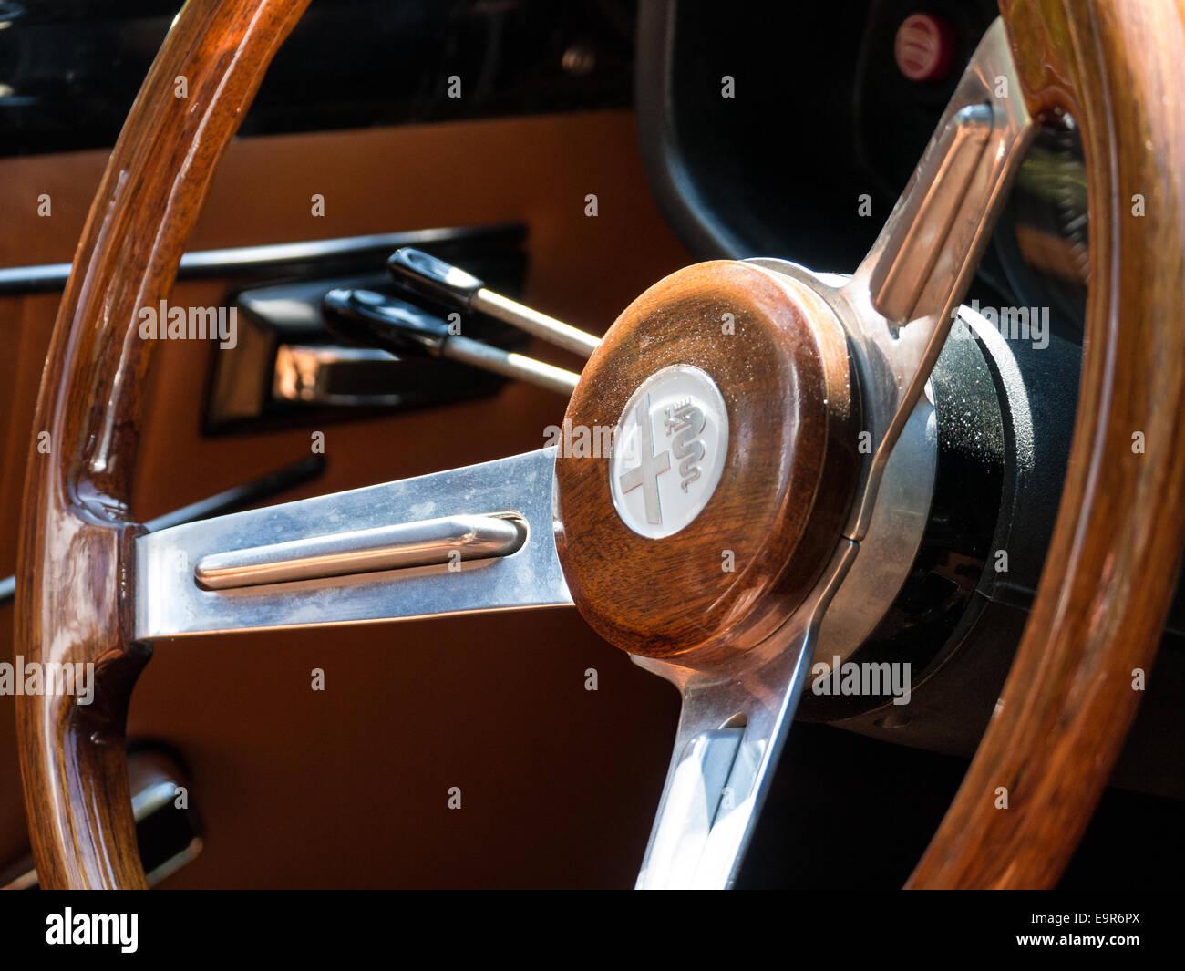 Wooden Steering Wheel In A Classic Alfa Romeo Racing Car Stock Photo
