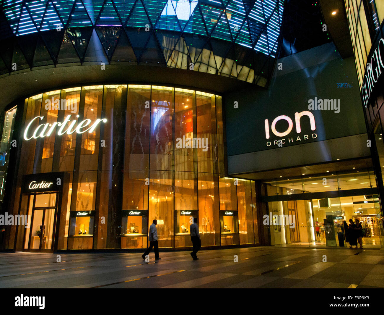 Luxury boutiques in a shopping mall in Orchard  Road,Singapore - Stock Image