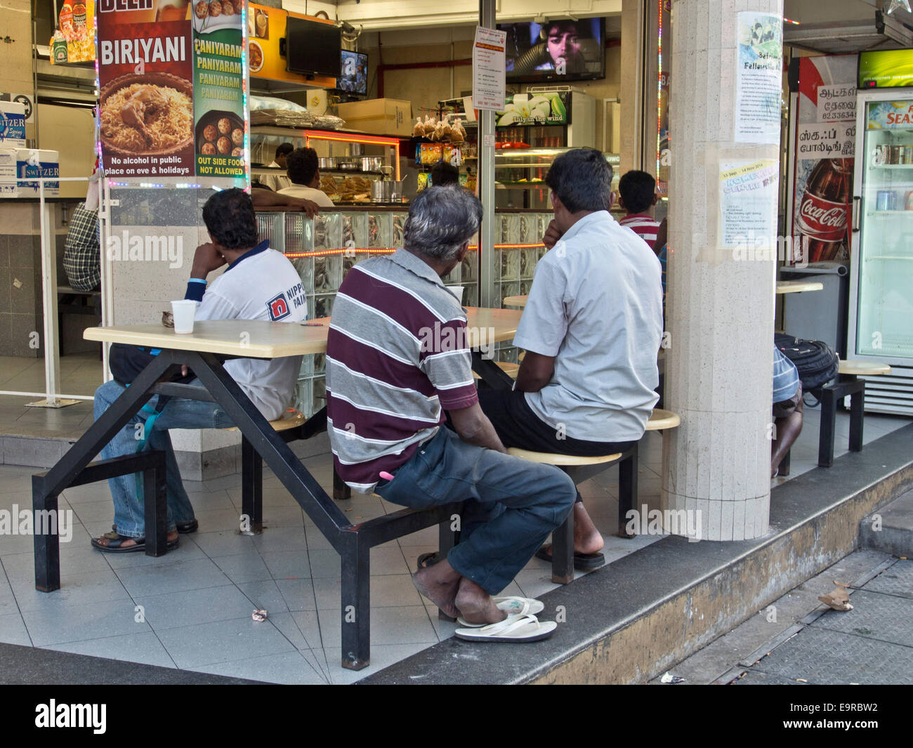 Men Watch Bollywood Movies In A Curry House In Little India