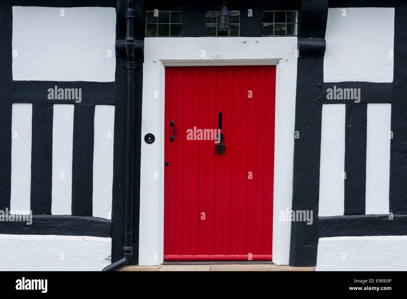 Red Front Door In A Traditional English Timber Framed Tudor House