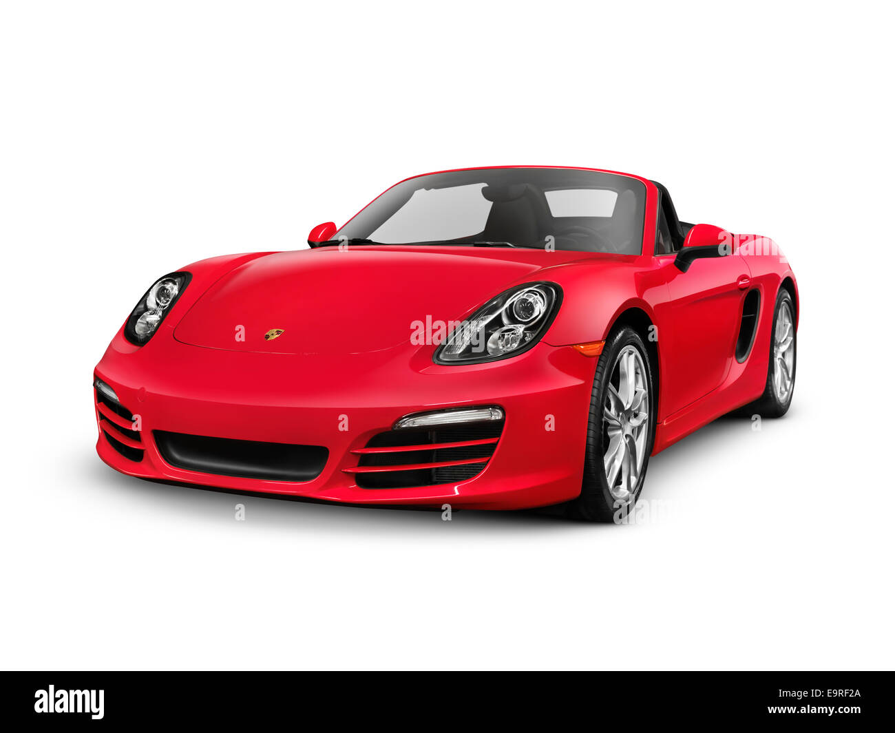 Red 2014 Porsche Boxster S Convertible luxury sports car isolated on white background with clipping path - Stock Image