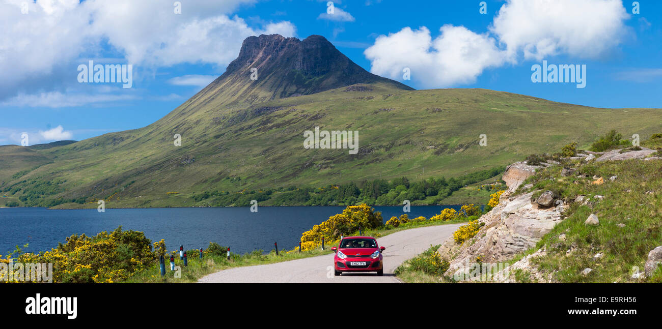 Motorist on touring holiday by Stac Pollaidh, Stack Polly mountain in Inverpolly National Nature Reserve in Coigach - Stock Image