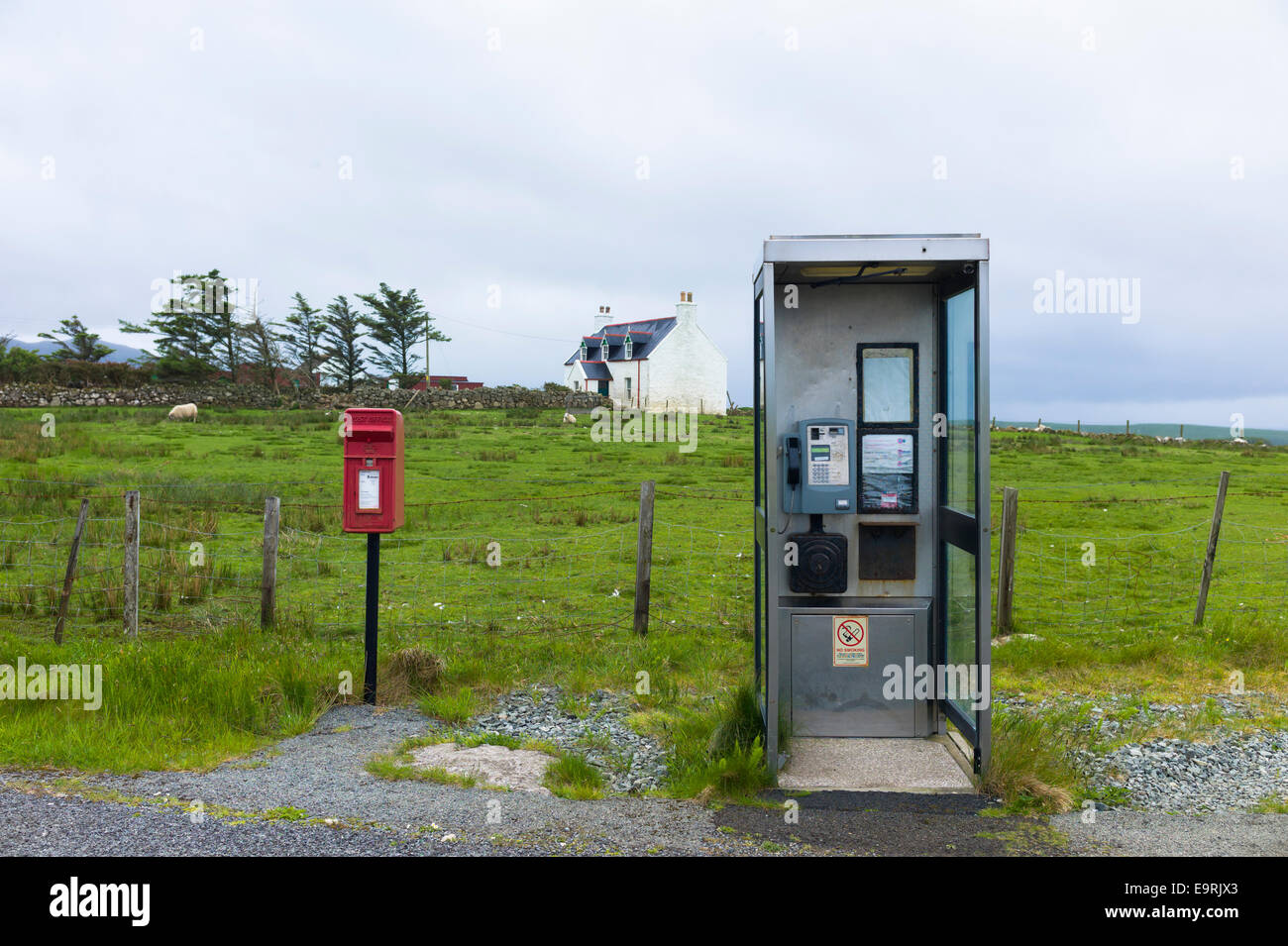 Traditional postbox and old-style public telephone box on Isle of Skye, the Western Isles of SCOTLAND, UK - Stock Image