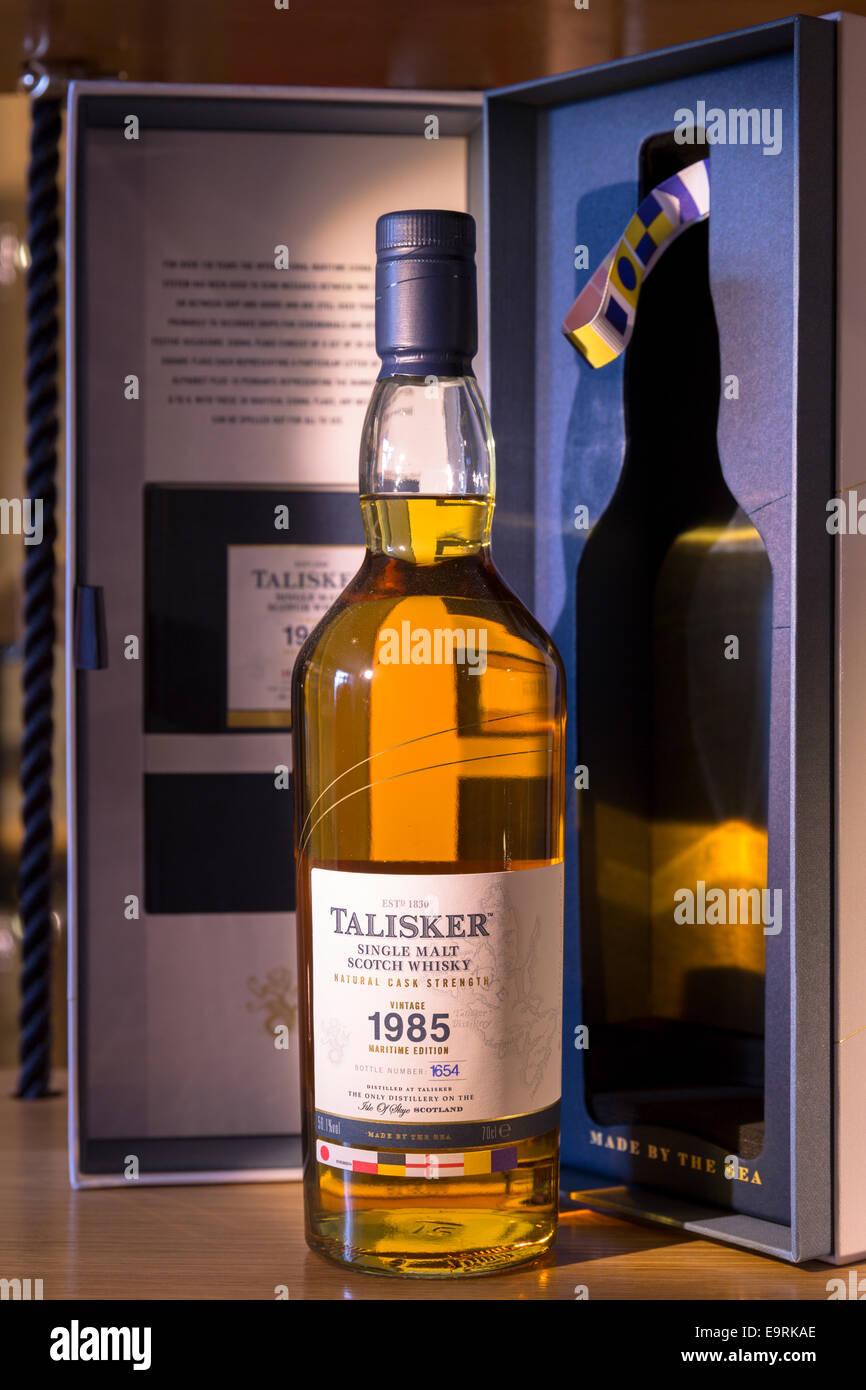 75cl bottle of 1985 vintage Talisker single malt Scotch Whisky and presentation case on display for sale at shop - Stock Image