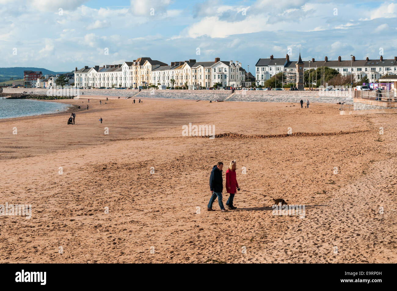 Exmouth sea front and beach with people out walking their dogs. - Stock Image
