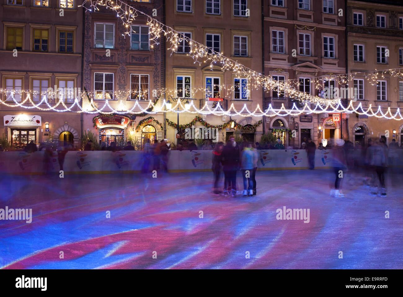 Ice rink during Christmas Time in the Old Town Square of Warsaw, Poland. - Stock Image