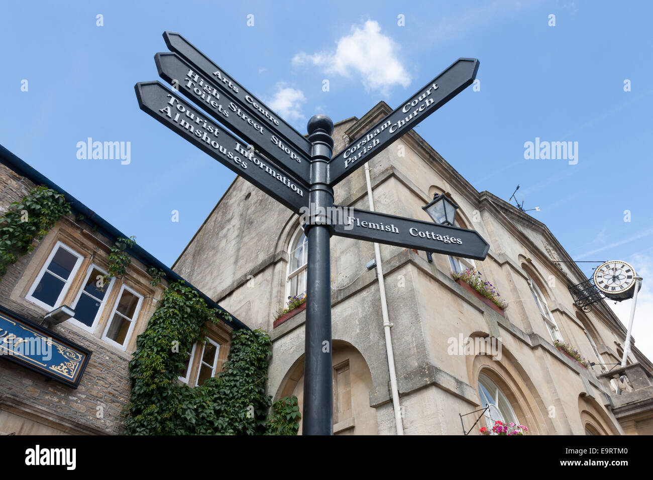 The Town Hall, Flemish Weaver public house and signpost in Corsham, Wiltshire Stock Photo