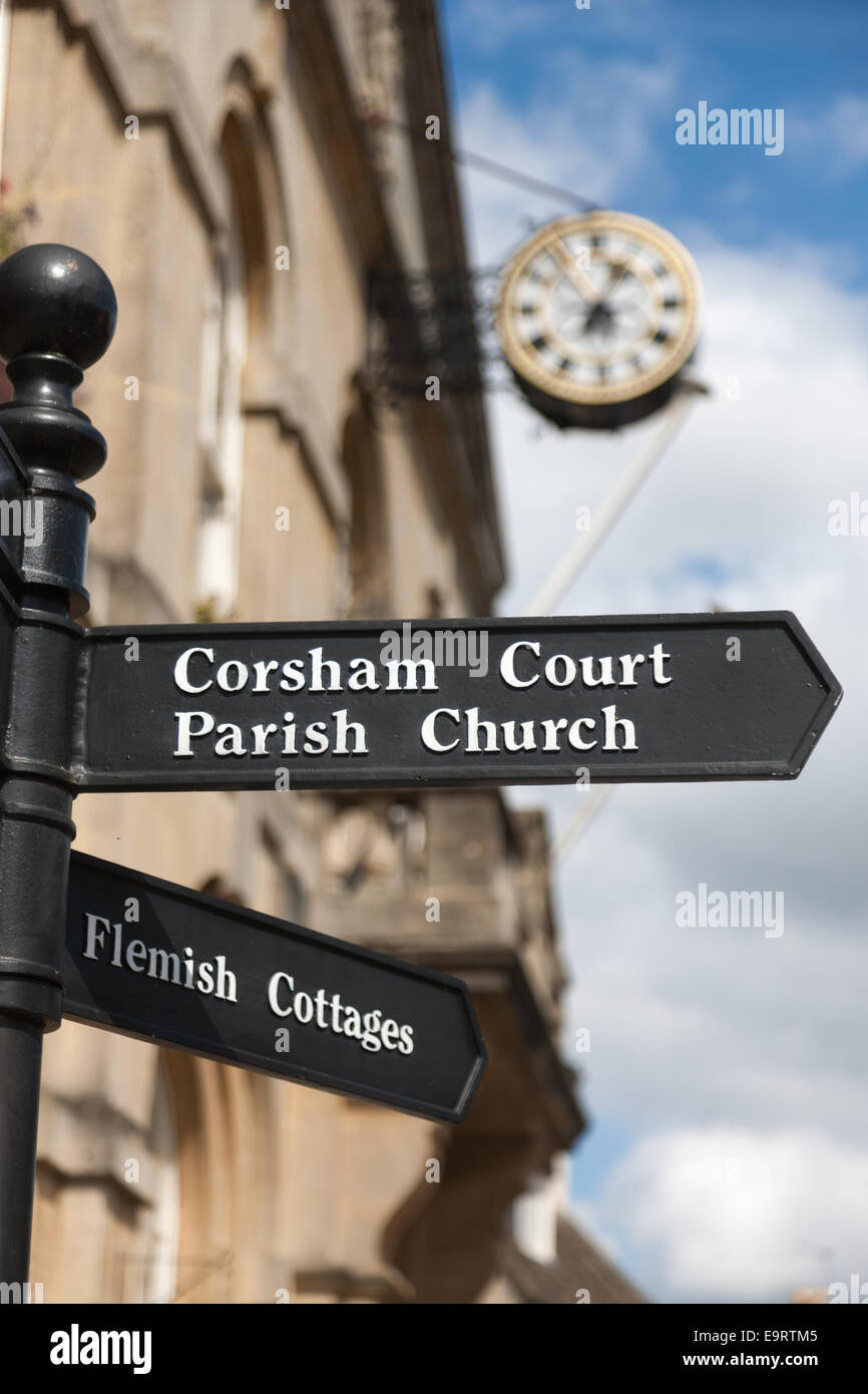 Corsham Town Hall with signposts, flagpoles and clock Stock Photo