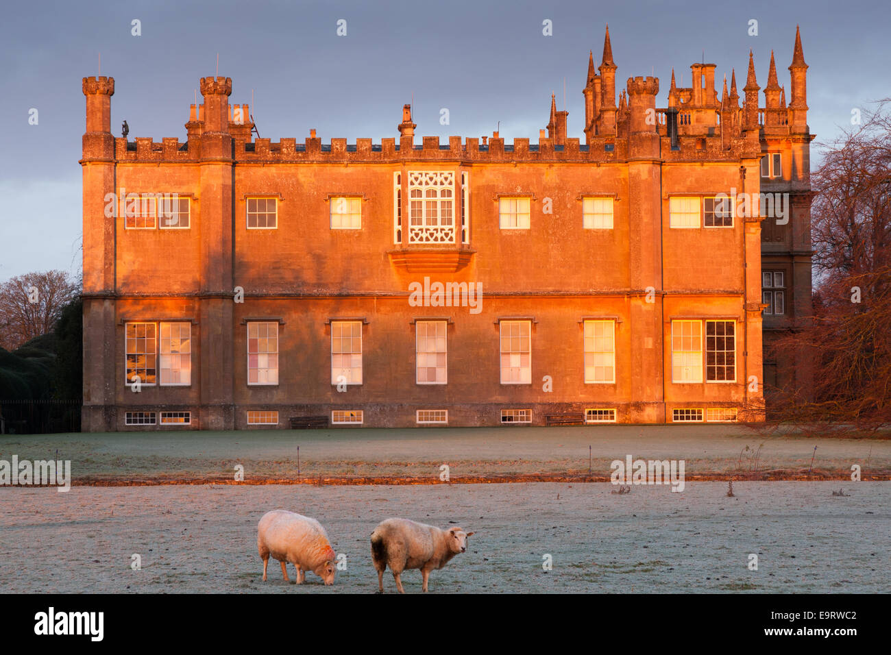 Corsham Court at sunrise, lit by the rays of the rising sun - Stock Image