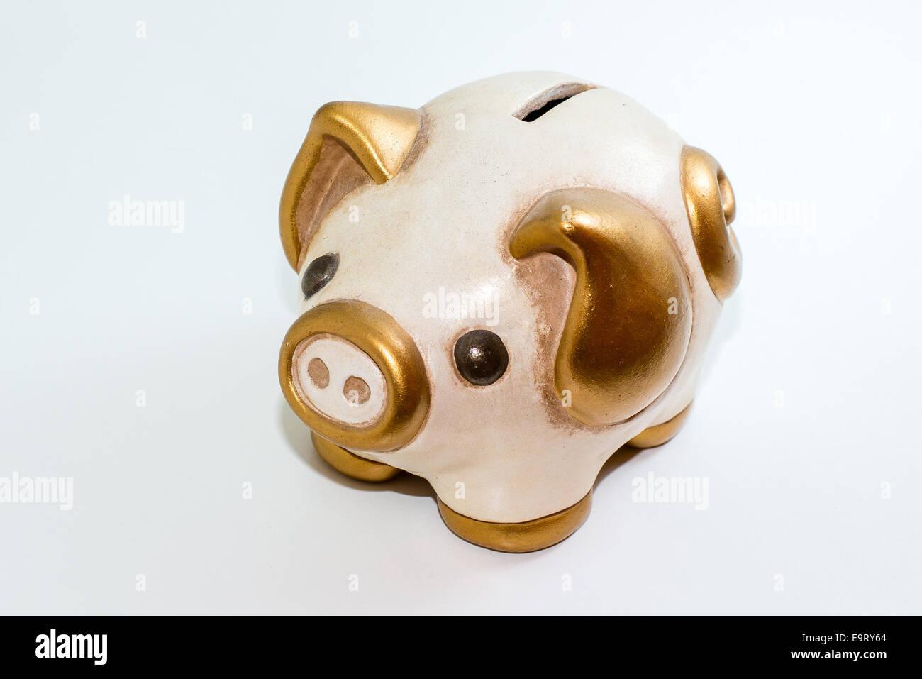 Ceramic money box with pig shape, isolated object on white background - Stock Image