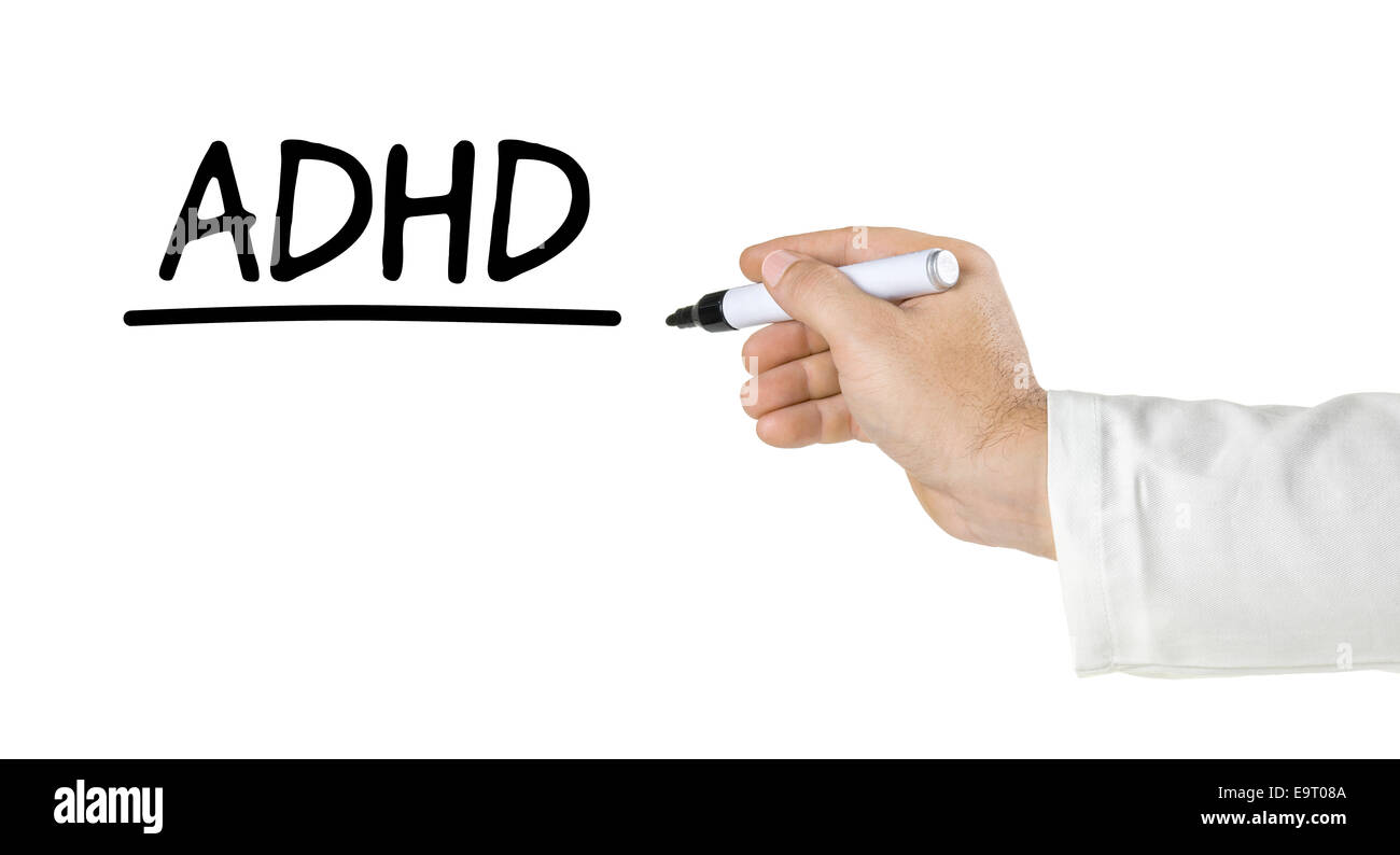 Hand with pen writing ADHD - Stock Image