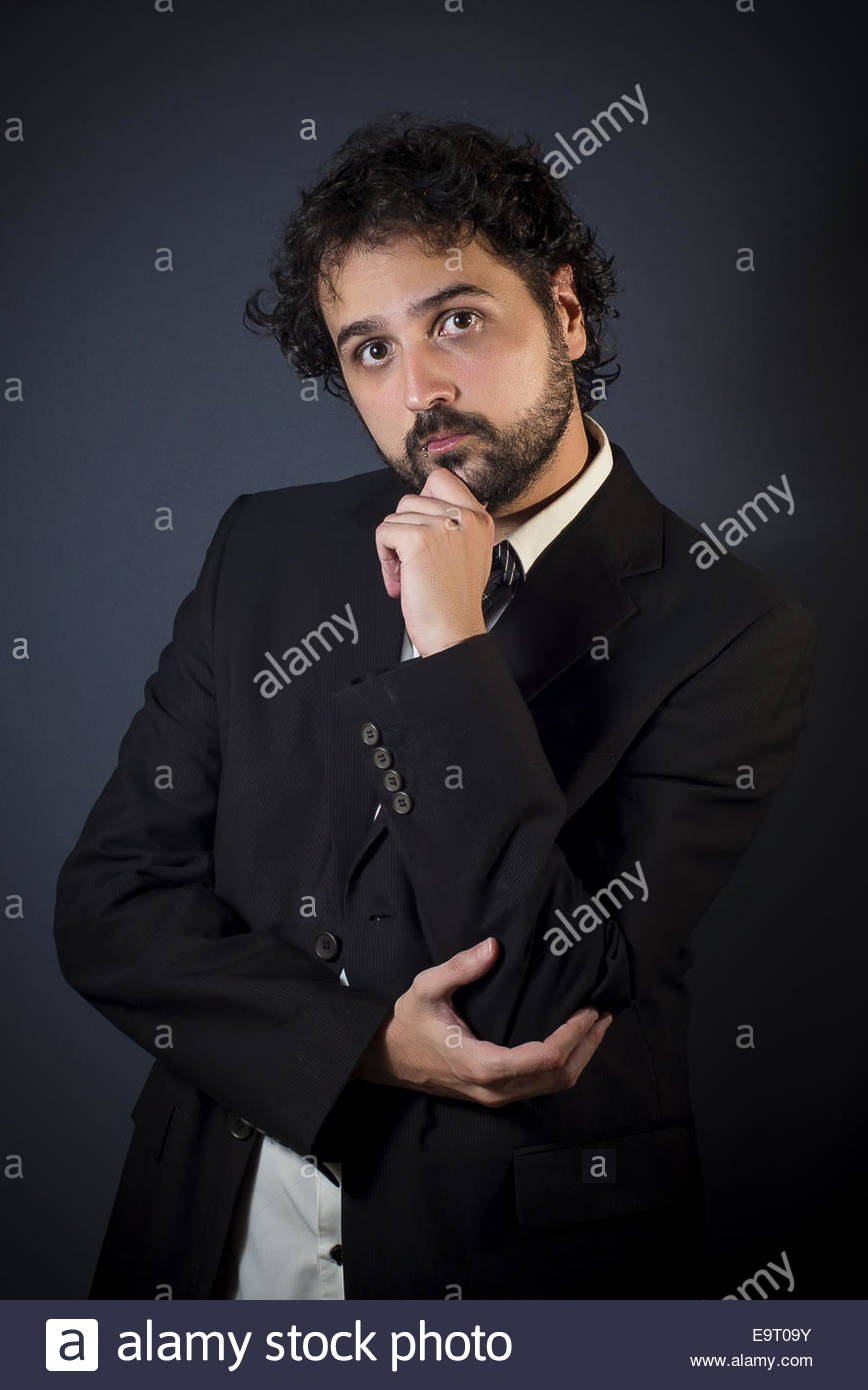 Portrait of young man with jacket - Stock Image