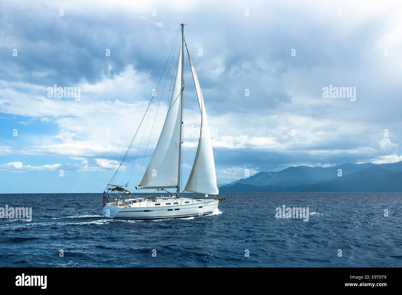 Sailing in cloudy weather. Yachting. Luxury yachts. - Stock Image