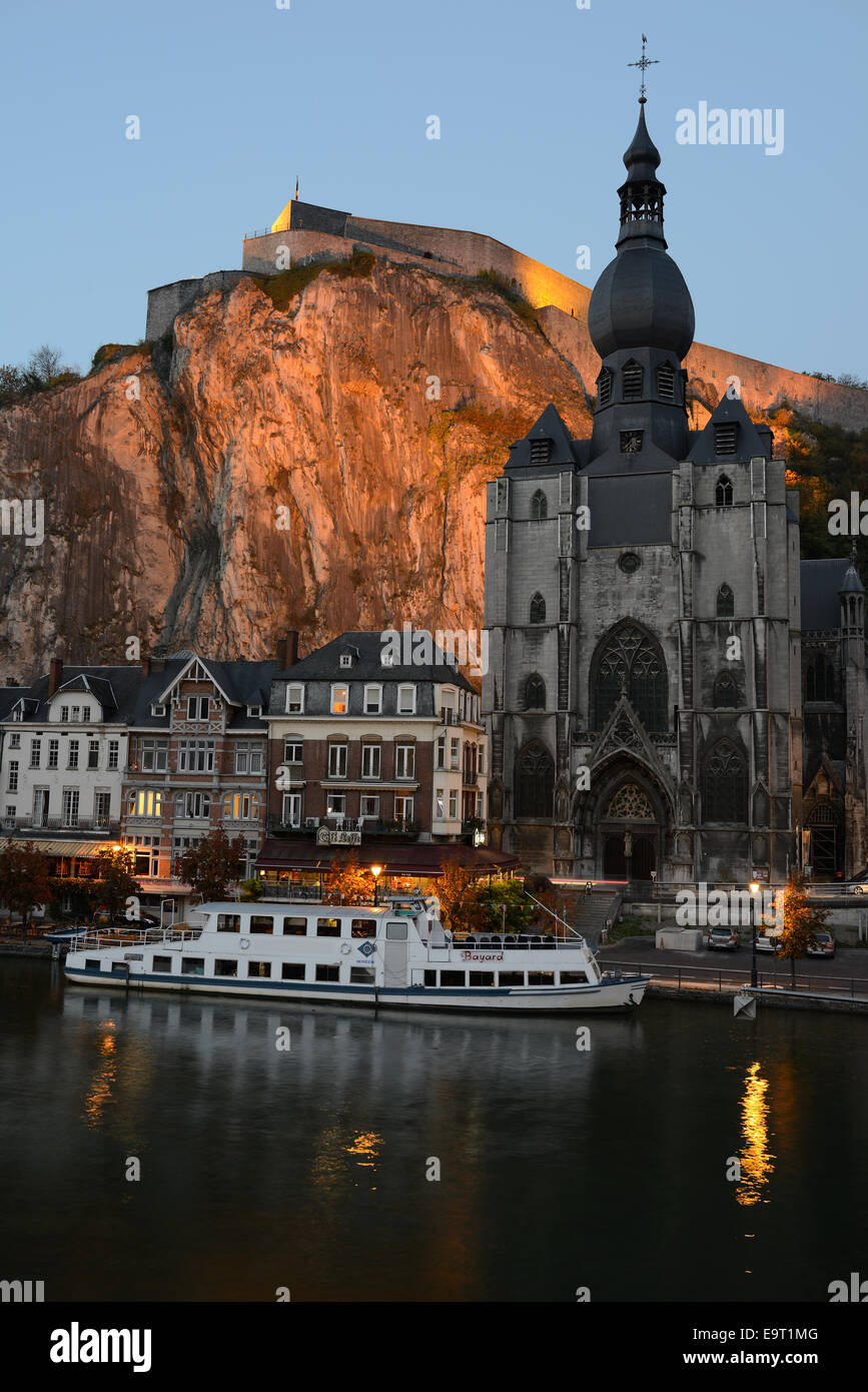 COLLEGIATE CHURCH & CITADEL OF DINANT AT TWILIGHT. Province of Namur, Wallonia, Belgium. - Stock Image