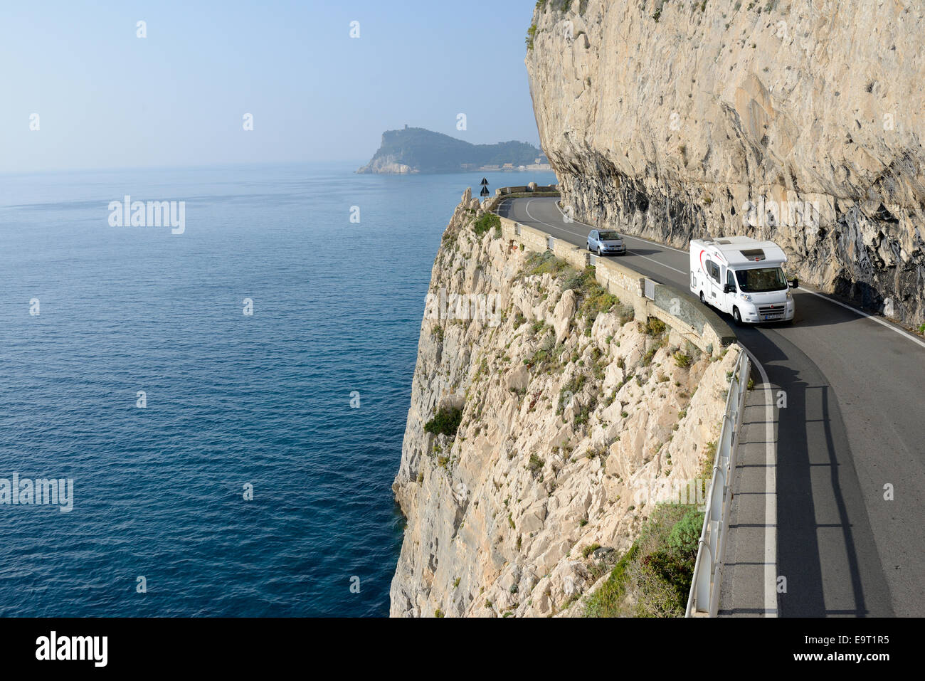 MOTORHOME ON A SCENIC ROAD BY THE MEDITERRANEAN SEA. Capo Noli, Liguria, Italy. - Stock Image