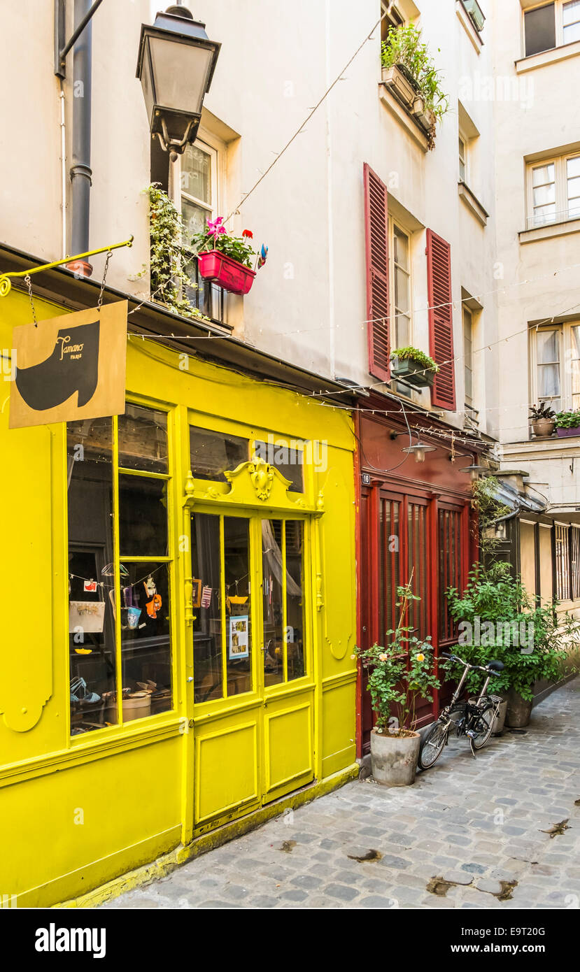 view of passage moliere with tamano paris shop selling coloful hand-sewn espadrilles and other handmade shoes - Stock Image