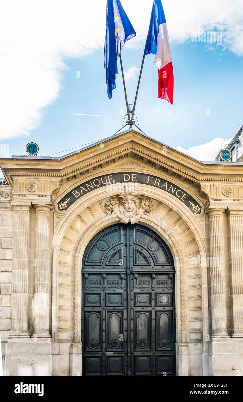 entrance door of french national bank, banque de france, with french flag and eu flag, paris, ile de france, france - Stock Image