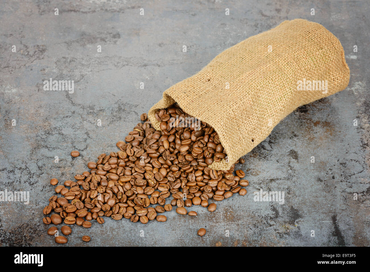 Coffee beans spilled out of the sack - Stock Image