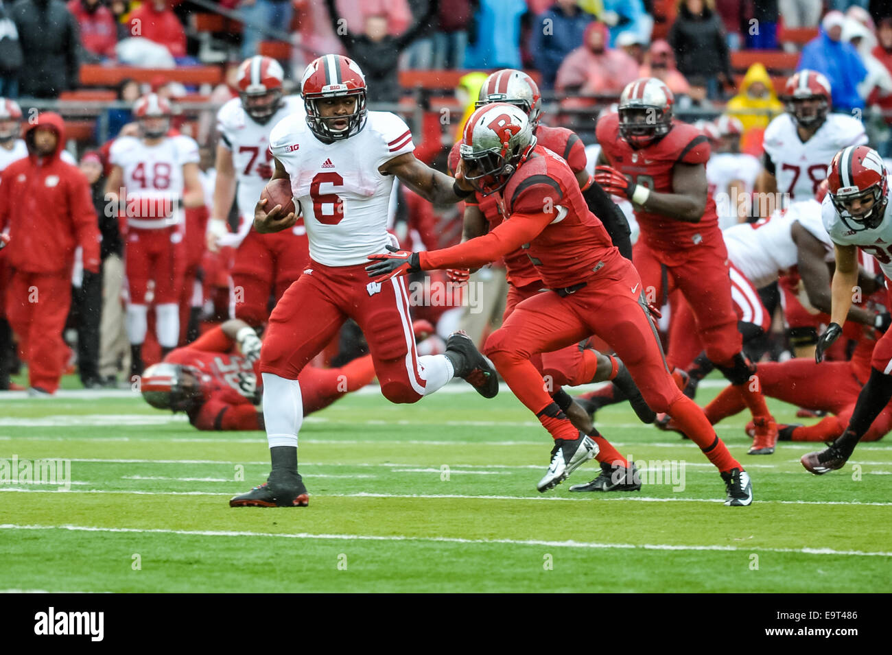 Piscataway, New Jersey, USA. 1st Nov, 2014. Wisconsin running back, COREY CLEMENT (6), stiff arms Rutgers defensive - Stock Image