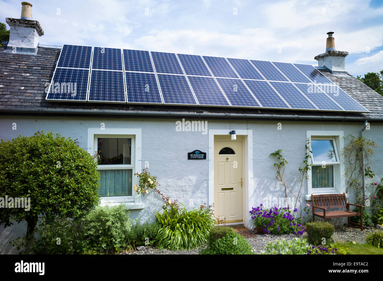 Solar panels environmental alternative energy on bungalow house at Salen Isle of Mull in the Inner Hebrides and - Stock Image