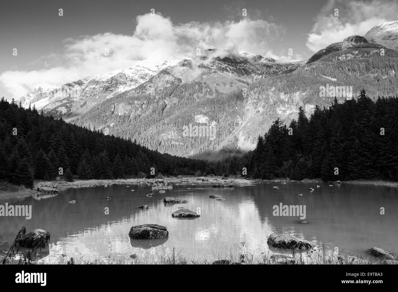 Chilkoot River near Haines Alaska in fall in  black and white. - Stock Image