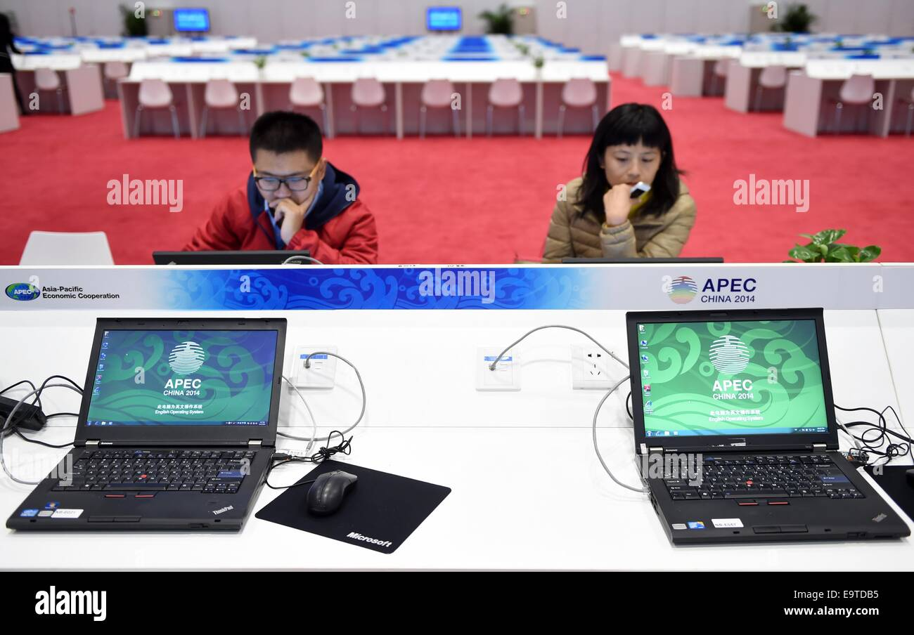 Beijing, China. 2nd Nov, 2014. Two journalists experience the working condition in the media center for the 2014 - Stock Image