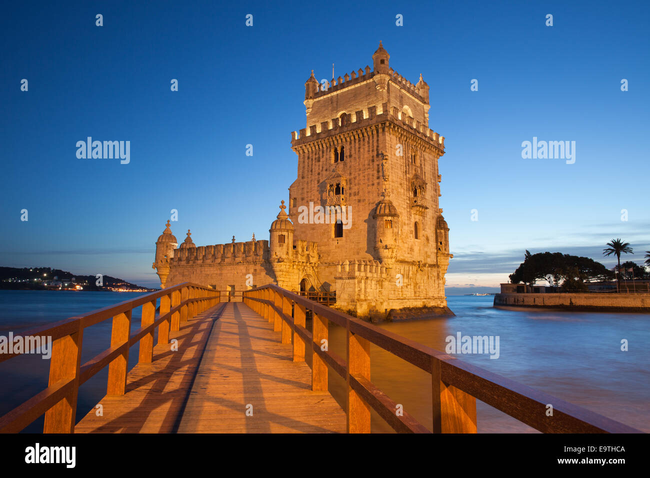 Belem Tower (Portuguese: Torre de Belem) on the Tagus river illuminated at night in Lisbon, Portugal. Stock Photo
