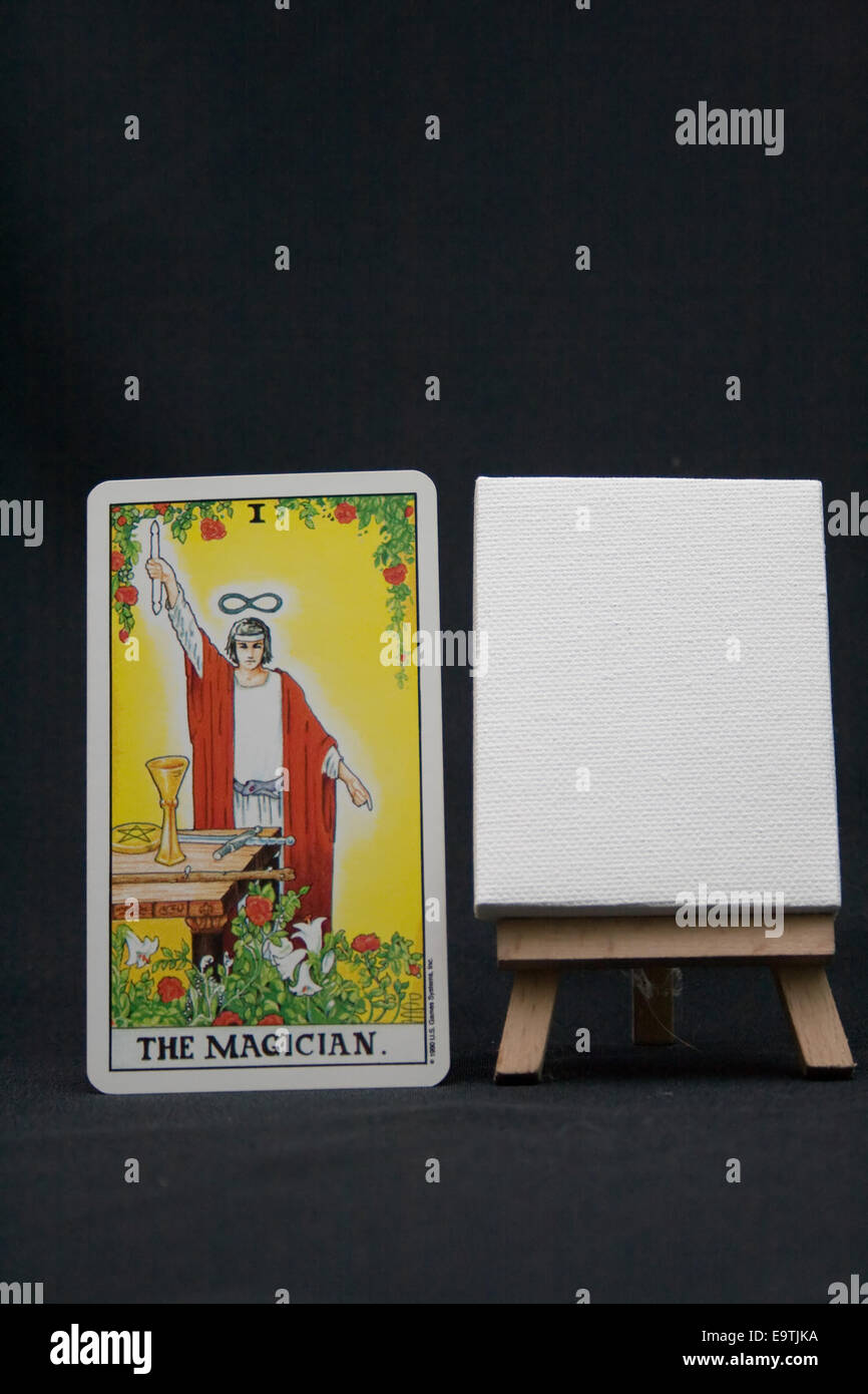 The magician tarot card with a blank easel on a dark background