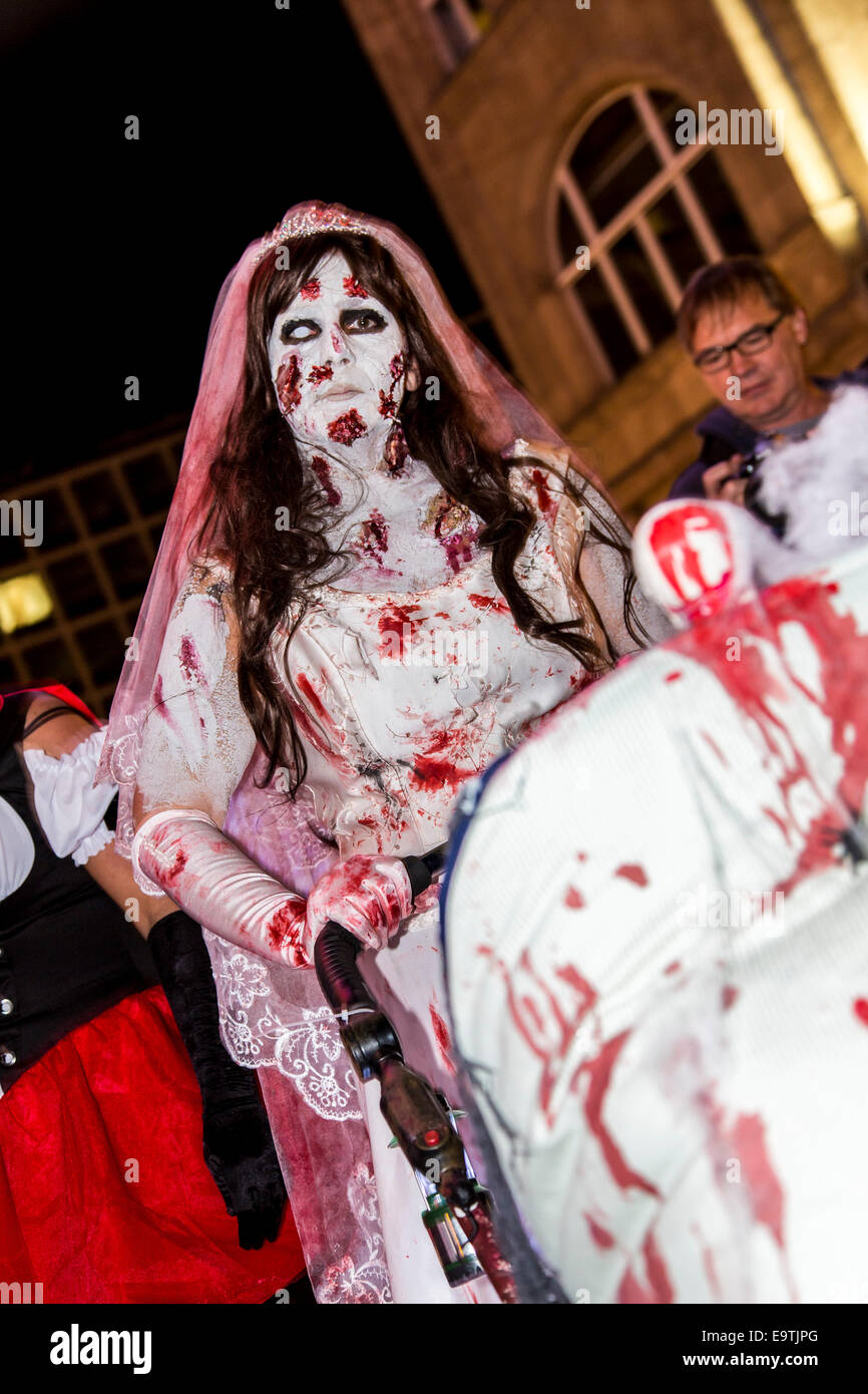 Zombie walk, a Halloween event, where more than 1000 people dressed and makeup, meet and walked through the city - Stock Image