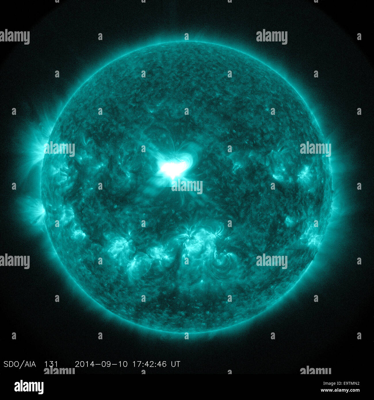 A Significant Flare Surges Off the Sun - Stock Image
