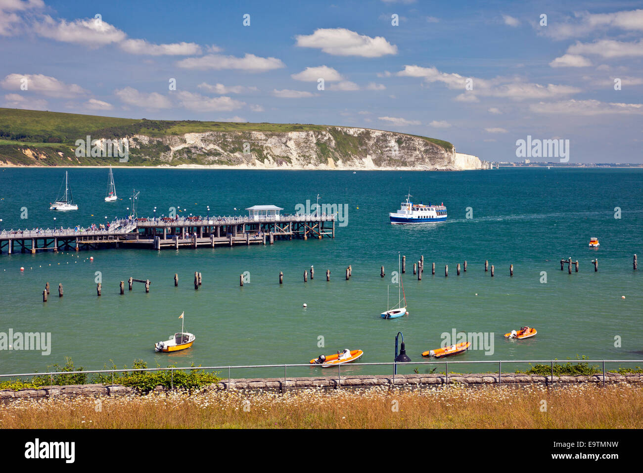 The 'Solent Scene' ferry from Poole arrives at the restored Victorian Pier in Swanage on the Jurassic Coast - Stock Image