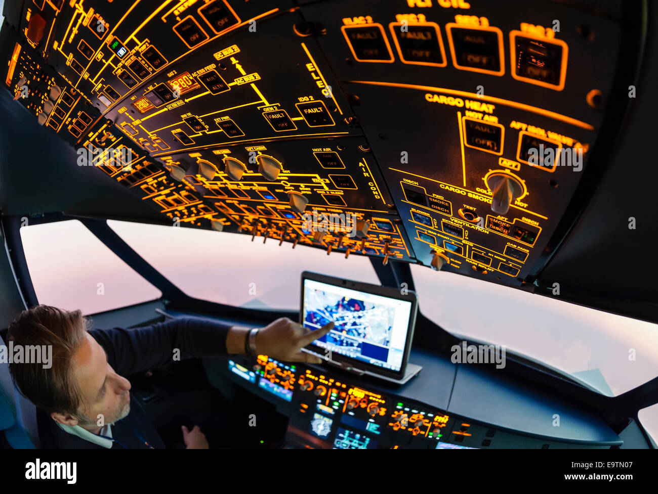 Cockpit of an Airbus A320 flight simulator that is used for training of professional airline pilots (pilot programming - Stock Image