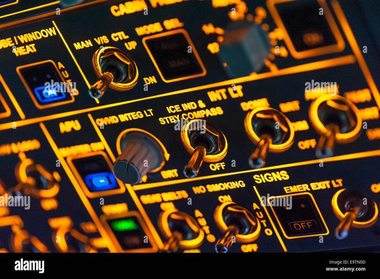 Cockpit of an Airbus A320 flight simulator that is used for training of professional airline pilots (overhead controls - Stock Image