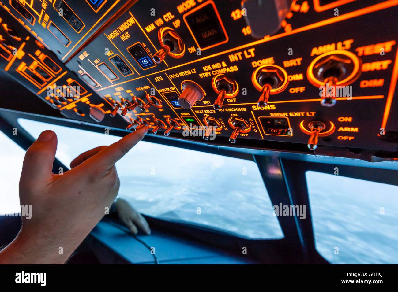 Cockpit of an Airbus A320 flight simulator that is used for training of professional airline pilots (during 'flight') - Stock Image