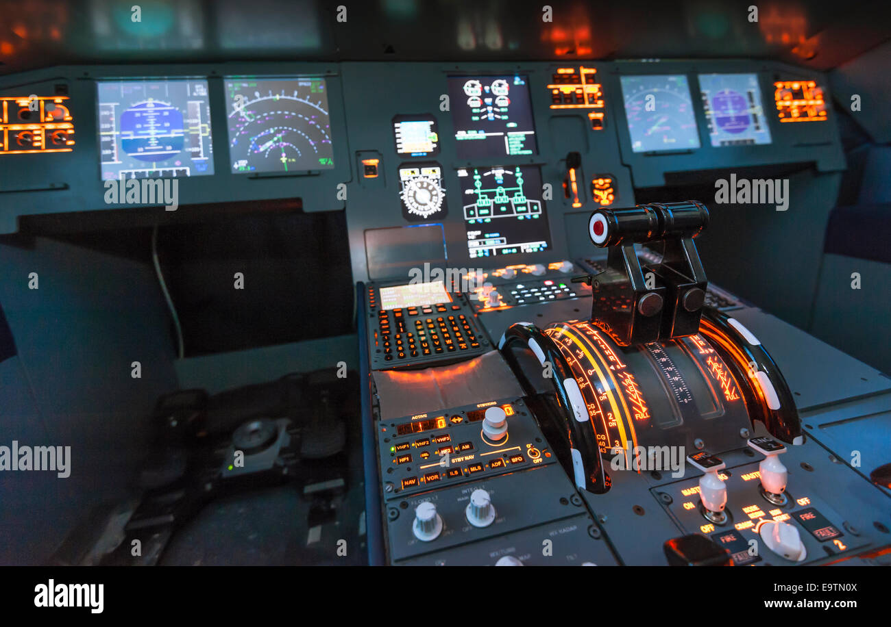 Cockpit of an Airbus A320 flight simulator that is used for training of professional airline pilots. - Stock Image