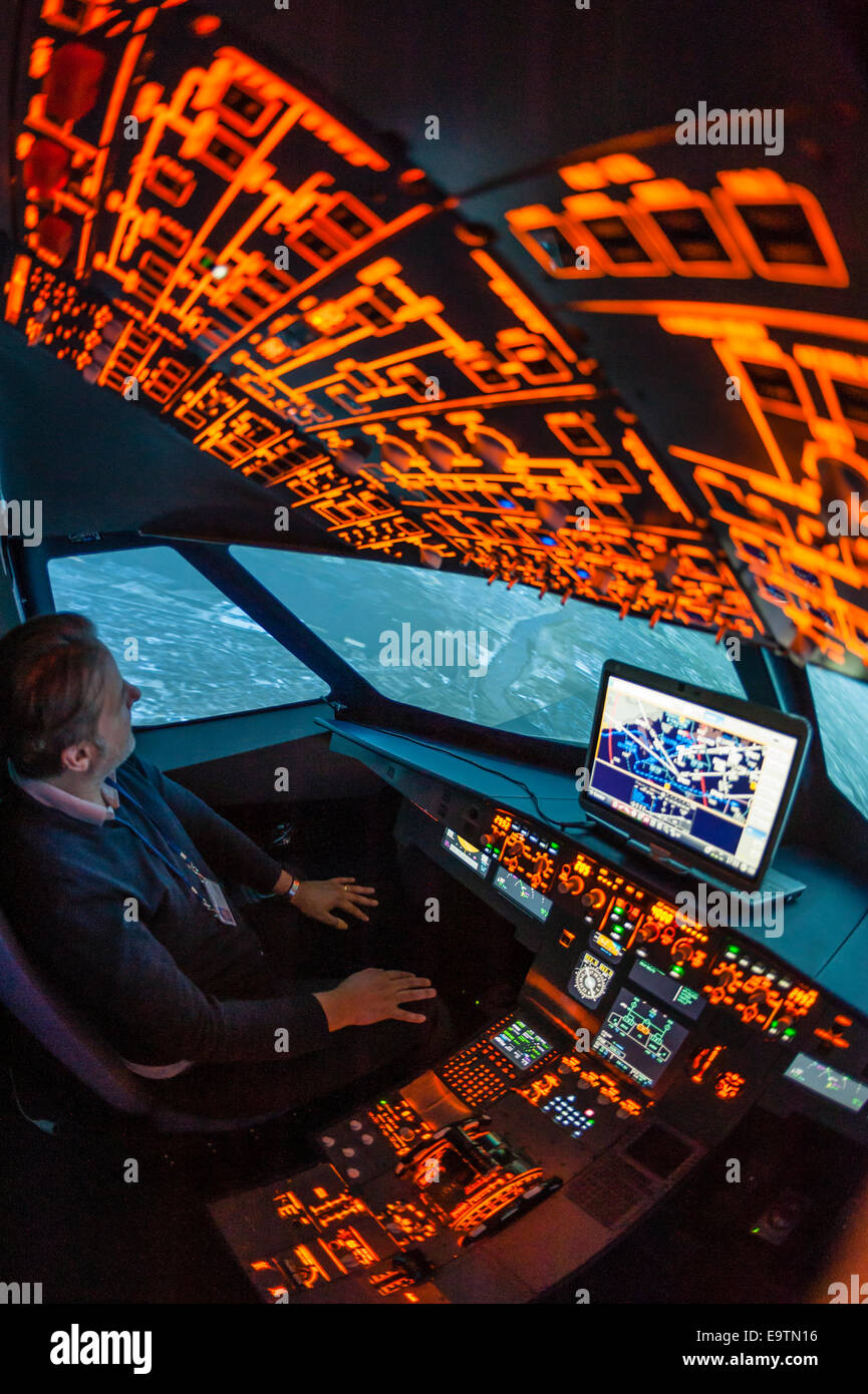 Cockpit of an Airbus A320 flight simulator that is used for training of professional airline pilots (during 'flight'). - Stock Image