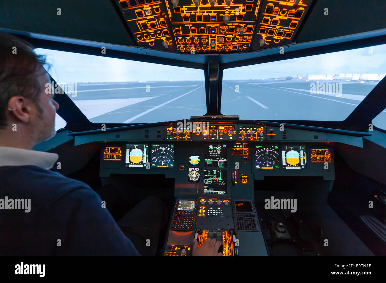 Cockpit of an Airbus A320 flight simulator that is used for training of professional airline pilots (preparing takeoff) - Stock Image