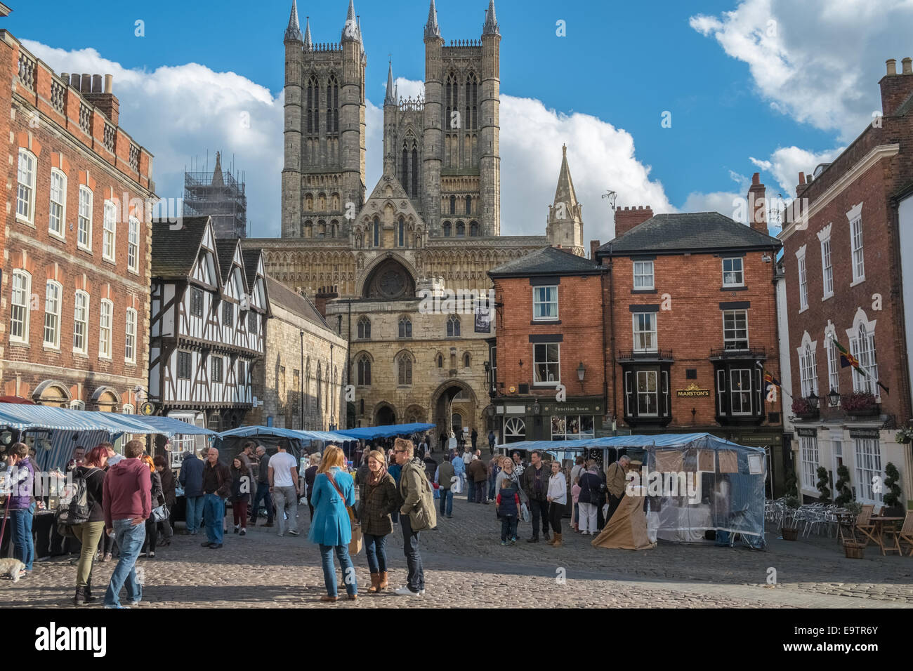 People in Lincoln market square, with cathedral in background, Lincoln, Lincolnshire, England UK - Stock Image