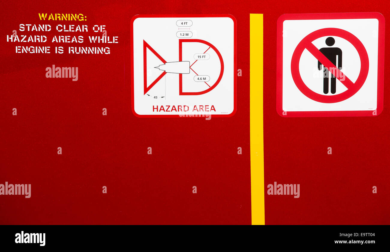 Warning signs on a Rolls Royce Trent 1000 turbofan aeroplane engine, used to power the Boeing 787 Dreamliner. - Stock Image